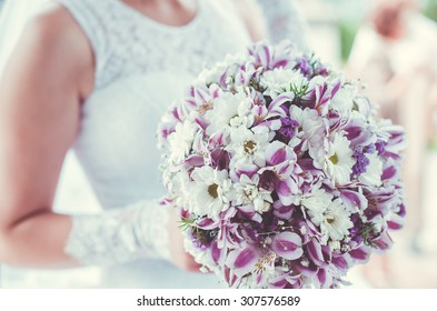 Beautiful wedding bridal bouquet in violet tones
