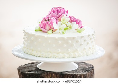 Beautiful Wedding Cake with flowers on top.