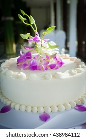 Beautiful Wedding Cake with Orchids on top.