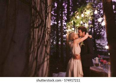 Beautiful wedding casual couple in love between trees with decoration