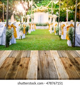Beautiful Wedding ceremony in garden at sunset with wooden floor perspective