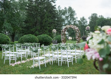 beautiful wedding ceremony in the park in the rain