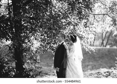 beautiful wedding couple celebrating their wedding day in autumn