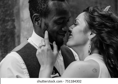 Beautiful wedding couple celebrating their wedding day ,happy african american groom and caucasian bride
