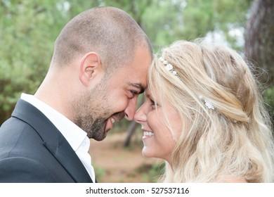 Beautiful wedding couple is enjoying wedding in park