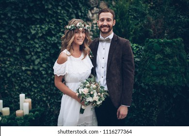 Beautiful wedding couple kissing and laughing