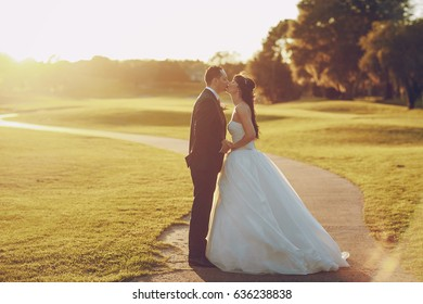 beautiful wedding couple on the Golf course during sunset