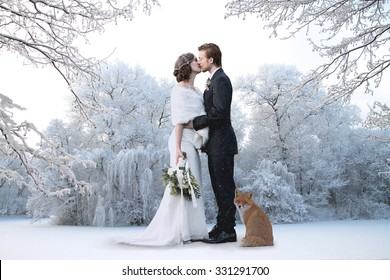 Beautiful wedding couple on their winter wedding