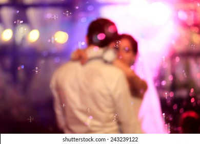 Beautiful wedding dance in soap bubbles,blur