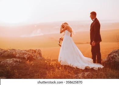 Beautiful wedding day, love on the sunset