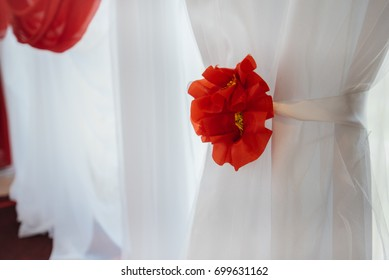 Beautiful wedding decor of flowers on a white openwork screen.