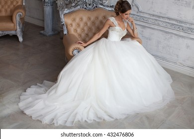 Beautiful wedding dress. Bride in wedding dress. Wedding dress in Paris. Bride in a luxury apartment in a wedding dress.
