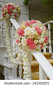 Beautiful wedding flower decoration at stairs