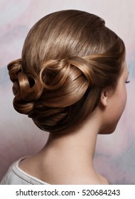Beautiful wedding hairstyle. The bride's hairstyle in the beauty salon. Rear view.
