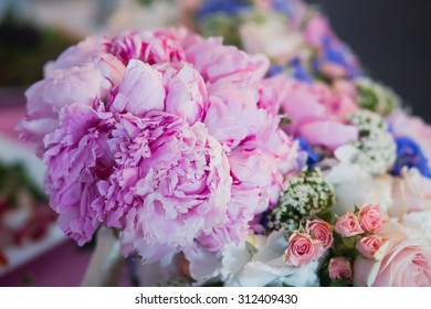Beautiful wedding interior and table decor, flower decoration with flowers bouquet, with roses, tulips, peonies