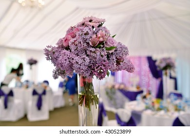 Beautiful wedding restaurant for marriage. White decor for bride and groom. Colorful decoration for celebration. Beauty bridal interior. Bouquet, food and flowers in hall