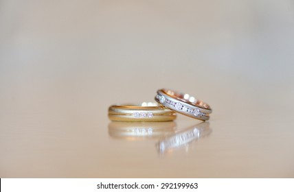Beautiful wedding rings for bride and groom. Beauty of wedding accessories indoors. Close-up bridal jewellery. Female and male decoration for couple. Jewelry for man and woman. Jewel of marriage