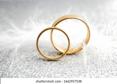 Beautiful wedding rings on silver background