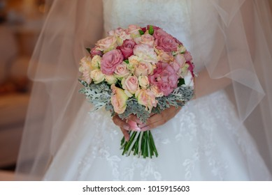 A beautiful wedding spring bouquet in the hands of the bride.