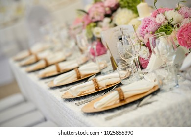 Beautiful wedding table decorations  with glasses, plate and flowers