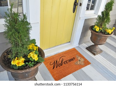 Beautiful welcome peach color coir doormat with Butterfly Placed outside door