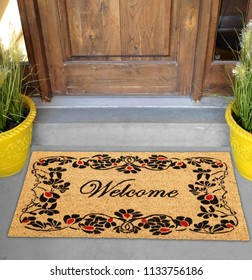 Beautiful welcome peach color coir doormat with flower border Placed outside door