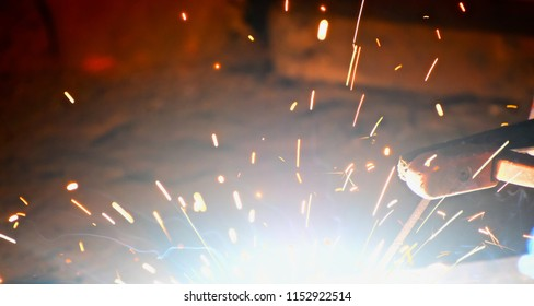 Beautiful welding sparks with smoke isolated unique blurry photograph