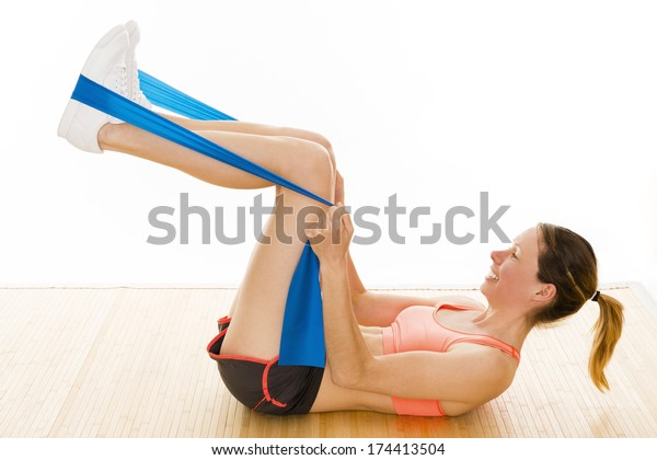 beautiful well trained woman is showing some gymnastic exercises