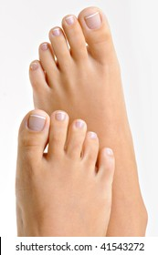 Beautiful well-groomed female feet with the French pedicure. Isolated on white.