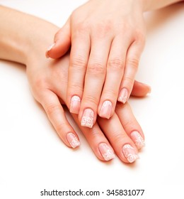 Beautiful well-groomed female hands with nail polish.