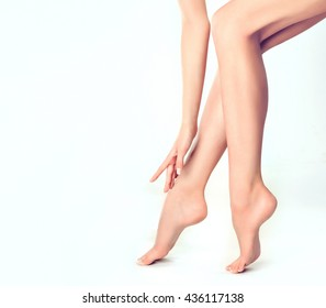 Beautiful well-groomed female legs . Foot care . Depilation of hair on the feet .