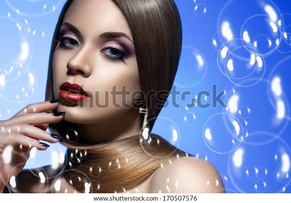 beautiful and well-groomed girl in soap bubbles