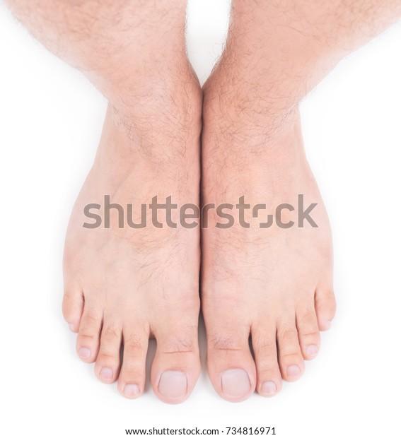 Beautiful well-groomed male legs. Male pedicure.