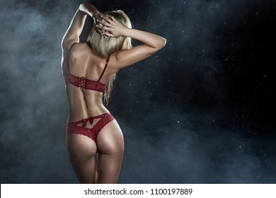 0d82b8ceb14 Beautiful wet sporty big tits tanned blonde girl wearing red underwear  posing from the back in
