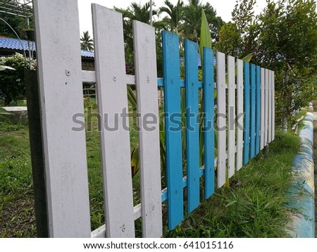 Beautiful White And Blue Wood Fence Around The Green Garden