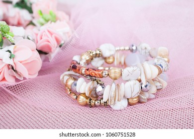 Beautiful white bracelet on a pink background