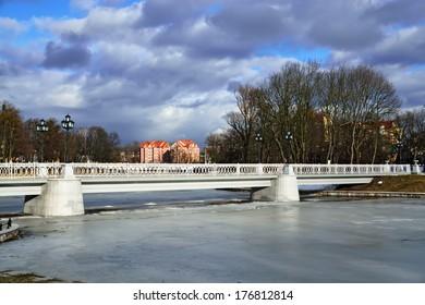 Beautiful white bridge on the Verhnee lake (before Oberteich). Kaliningrad (before 1946 Koenigsberg), Russia