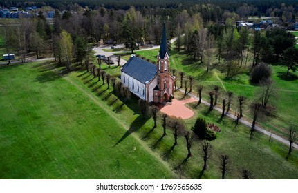 Beautiful white Catholic Church in Latvia ,Aglona, nice blue sky and white clouds. Green grass and trees.