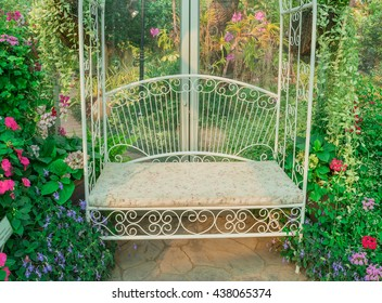 Beautiful white chair or white bench and flowers in flower  green glass garden with morning sun light