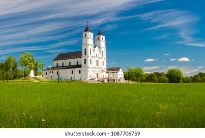 Beautiful white Chatolic Church in Latvia ,Aglona, nice blue sky and white clouds