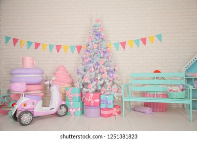 Beautiful White Christmas Tree Decorated by pink flowers and purple ribbons and bows in the cute childish room. Nobody.