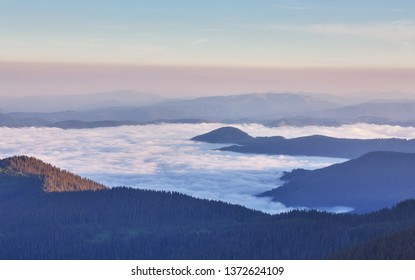 Beautiful white cloud sky, with fog on the morning. Fog in the morning with mountain .Mist with mountain backdrop.sunny early in the morning.