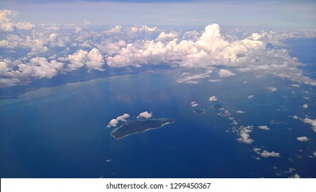 beautiful white clouds and raincloud in blue sky view From a plane,Can see Pulau Babi Besar, Pulau Babi Tengah and Pulau Babi Hujong island teritory of malaysia in South China Sea