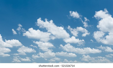Beautiful white clouds in summer on clear sky