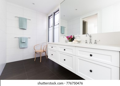 Beautiful white contemporary classic styled clean white bathroom
