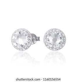 beautiful white diamond stud earrings with reflection on white background
