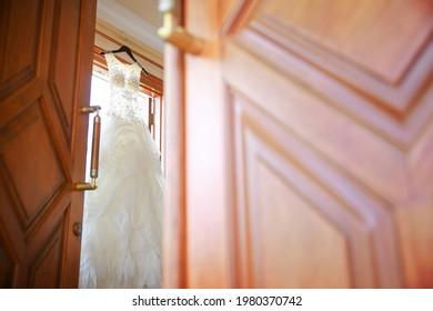beautiful white dress inside , please open the door