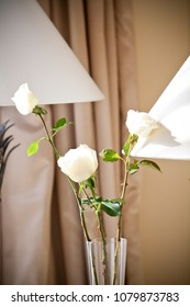 Beautiful white flower in a glass vase inside the luxury hotel