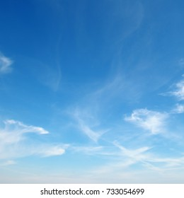 beautiful white fluffy clouds on background clear blue sky