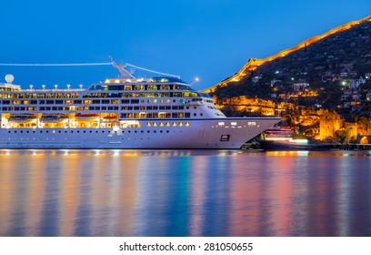 Beautiful white giant luxury cruise ship on stay at Alanya harbor